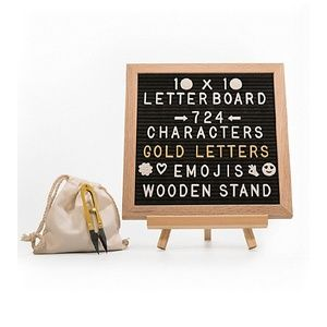 Black letter board with white/gold letters